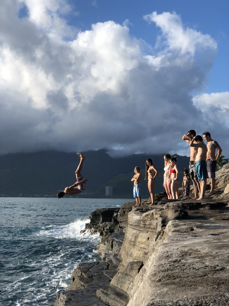 Diving off a cliff on a vacation